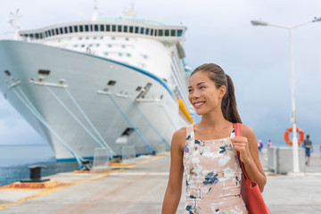 Happy carefree freedom woman in front of cruise ship. Caribbean luxury travel vacation concept.