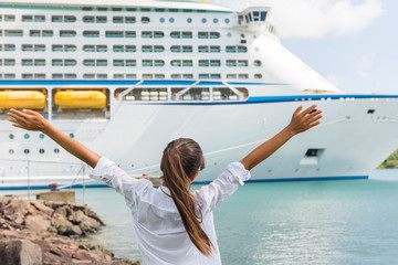 Wall Mural - Happy carefree freedom woman in front of cruise ship. Caribbean luxury travel vacation concept.