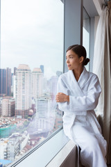 Spa woman relaxing at hotel room window