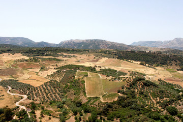 Spain. Andalucia. Ronda. Mountains and field on blue sky background, horizontal view.