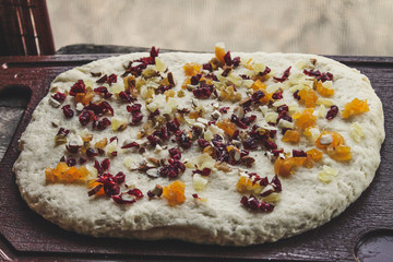 Dried fruits and candied fruits are finely chopped - additive in dough (pastry)