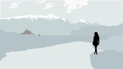 渓谷の城を見つめるシルエット