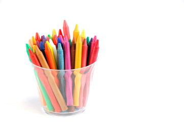 colorful crayons in the plastic cup isolated on white background