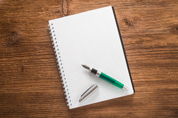 Notepad with a pen on the table