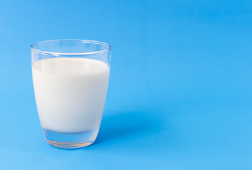 Glass of milk on blue background, food and drink for healthy concept