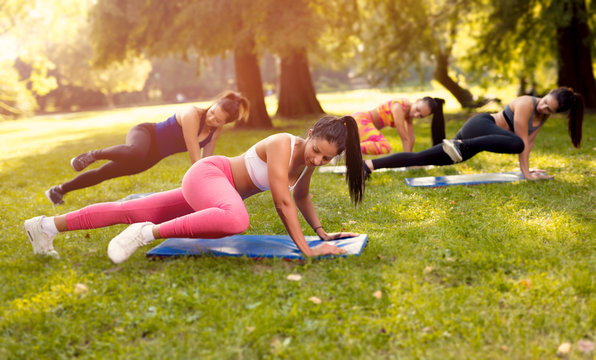 Four Young Women Exercising In Nature