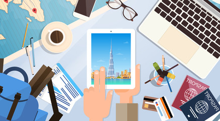 Hand Hold Tablet Computer With Dubai Skyline Panorama, Traveler Workplace With Passports Top Angle View Flat Vector Illustration