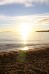 bright sunset on a coromandel peninsula beach