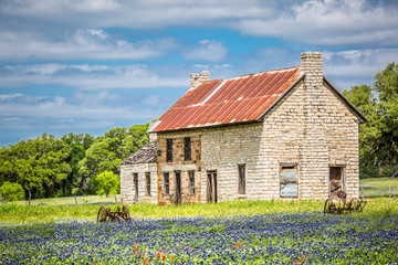 Bluebonnet House (mid-19th century) Marble Falls Built in the mid-19th century, this abandoned two-story limestone house sits in fields of bluebonnets