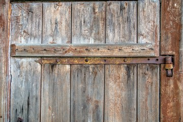 metal part on an old wooden door
