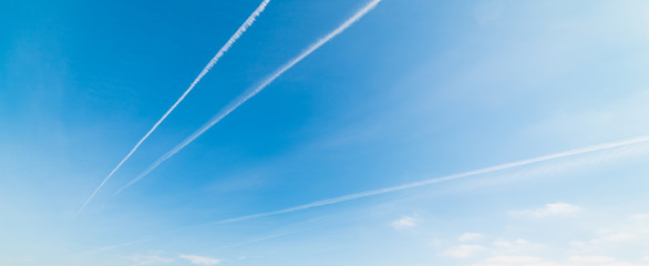 Blue sky with contrails