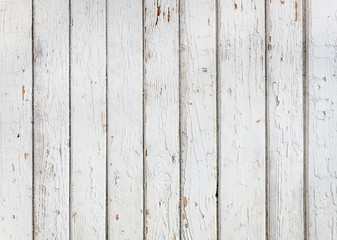 Wood plank fence with an old paint white color close up. Detailed background photo texture. Wooden wall abstract background.