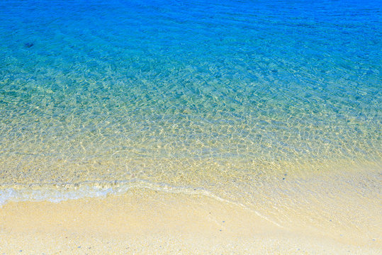 Soft wave of the blue sea on the sandy beach