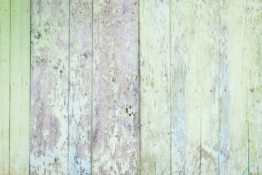 Old rural wooden wall in light pastel colors, detailed plank photo texture. Natural wooden building structure background.