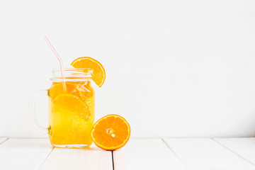 Fresh orange cocktail on white wooden background