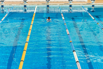 Girl Swimming Gala Pool Overhead Outdoors.