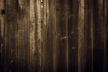 Old rural wooden wall in dark brown and black colors, detailed plank photo texture. Natural wooden building structure background.