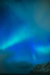 Amazing and Unique Northern Lights Aurora Borealis Over Lofoten Islands in Norway, Over the Polar Circle.
