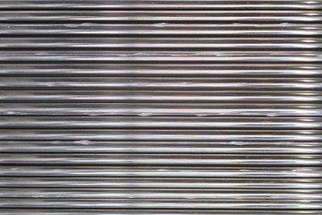 Background image of a texture of a metal undulating surface