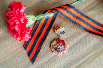 9 May card - closeup of medal of Great patriotic war with red carnation and George ribbon