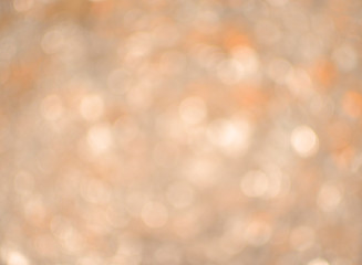 Bokeh background blur of duo tone sparkles in warm tones