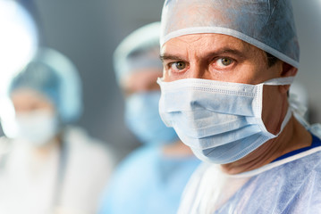 Mature medical person ready for operation