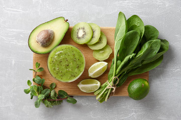 Healthy green smoothie and ingredients: kiwi fruit, avocado, fresh spinach, lime, mint herb