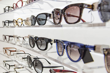 Sunglasses and eye glasses in a store. Wall mural