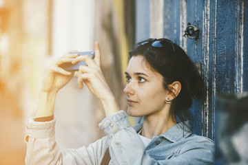 Girl taking photos with her smartphone