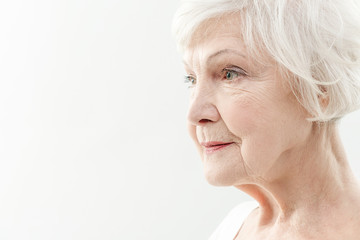 Wrinkled old woman thinking about life