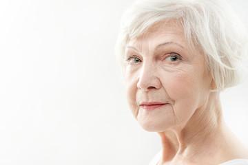 Serine senior lady with wrinkles on face