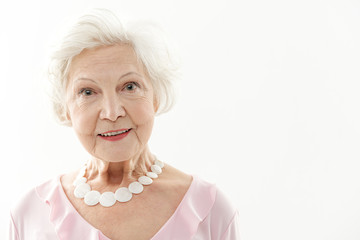 Cheerful senior lady with genuine smile