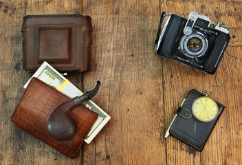 Old camera on a wooden background.