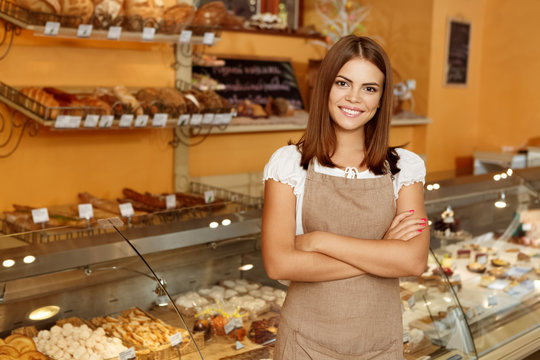 Young woman posing in her bakery