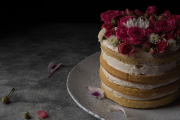Delicious cake decorated with natural roses