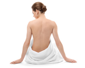Beautiful naked woman with towel on white background