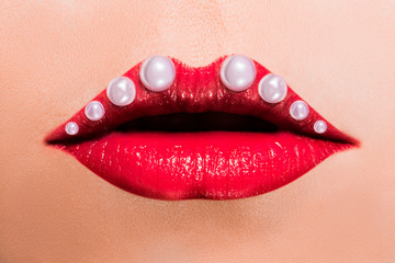 Poster Fashion Lips Beautiful red female lips with pearls.