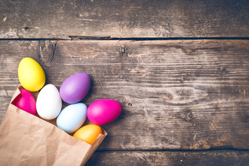 Easter Eggs on old boards. Painted eggs. Old board background. Easter ideas. Easter eggs. Space for text. Image in trendy toning.