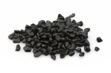 Natural stones of crumb black agate for decoration on a white background. Isolated