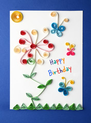 Fancy handmade gift card on blue background