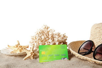 Sand with credit card and hat on white background