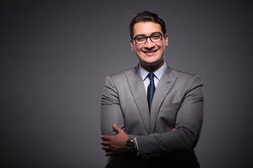 Handsome businessman against dark background