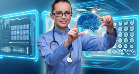 Female doctor with the brain in medical concept