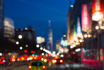 Blurred night lights of Manhattan street in New York City, NYC