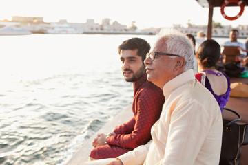 Family traveling on boat at Dubai Creek.