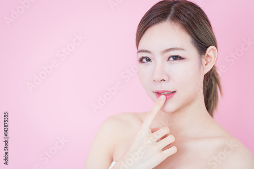 5dc35d2061 Portrait of young beautiful asian woman touch her clean fresh skin face.  cosmetology