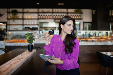 Woman with digital tablet at restaurant.