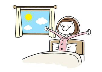 朝を気持ちよく起きる若い女性