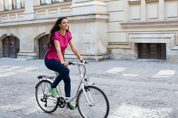 Young woman riding bicycle.