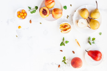 Sliced peaches and pears on white background. Flat lay, top view, copy space